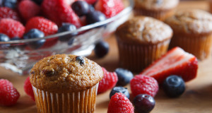 Assortment of fresh bran muffins and colorful berries