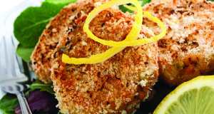 Salmon cakes appetizer on bed of lettuce with lemon