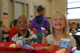 Whittier Elementary_Boy+Girl_EatingApples